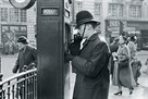 Policeman At Police Telephone Box, 1953 by Henry Grant